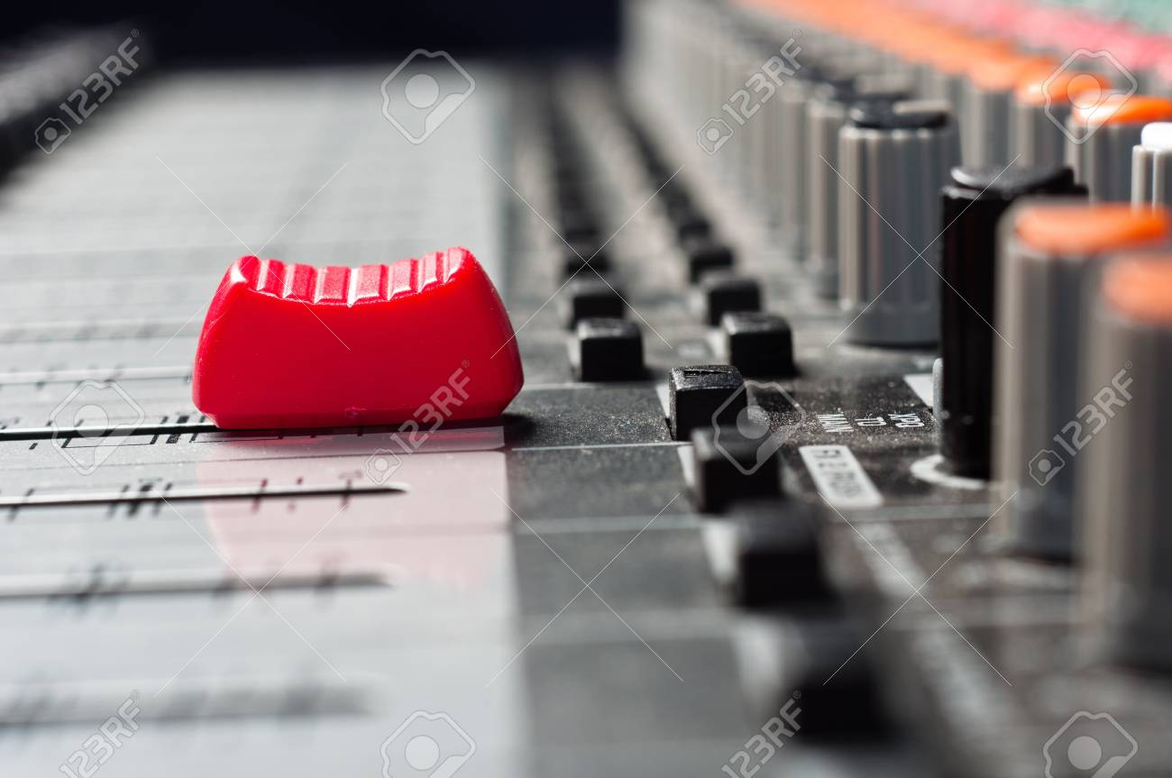 Part of an audio sound mixer with buttons and a slider Stock Photo - 9485687