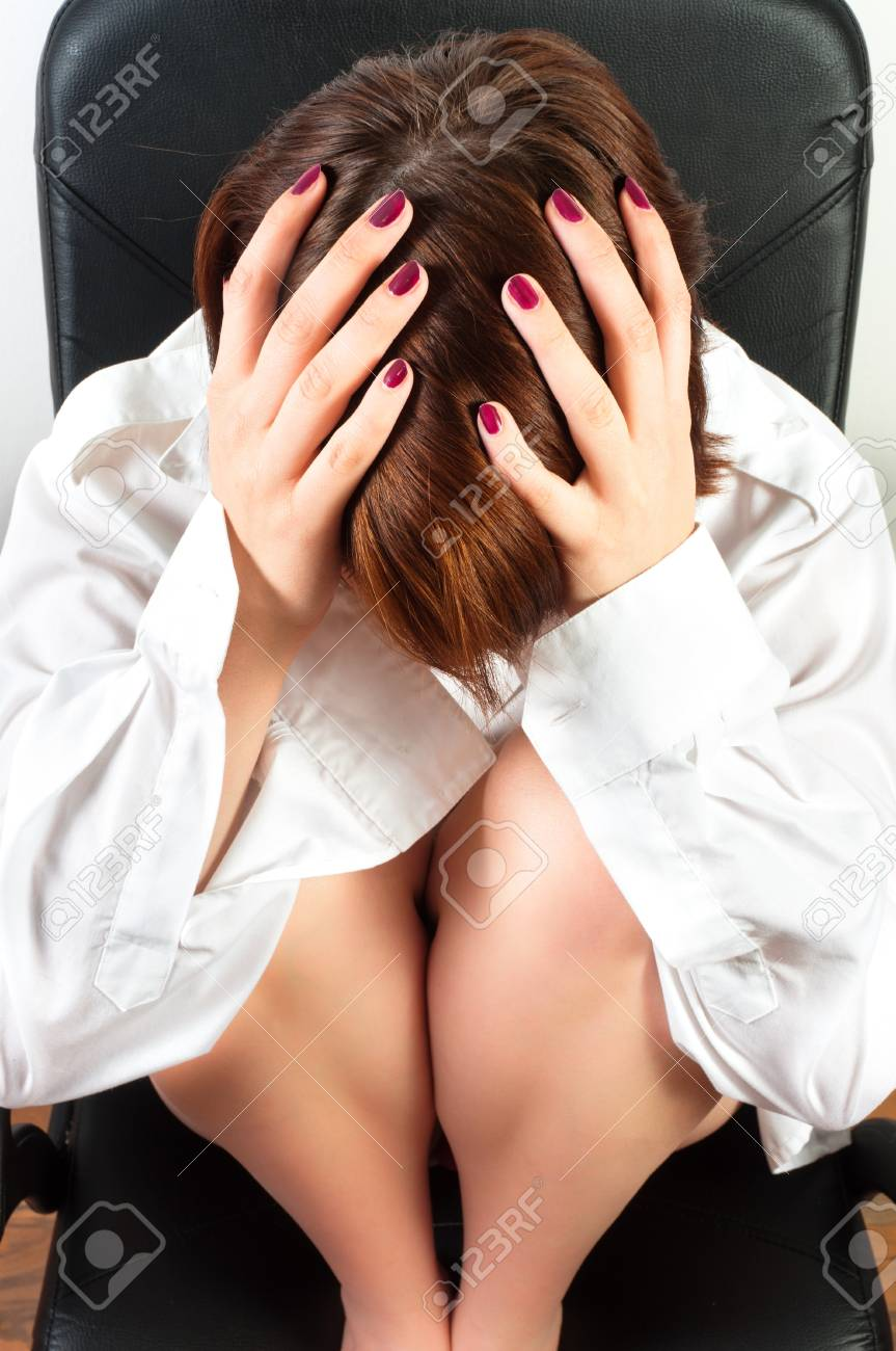 Young girl holding her head in a business chair Stock Photo - 9594935