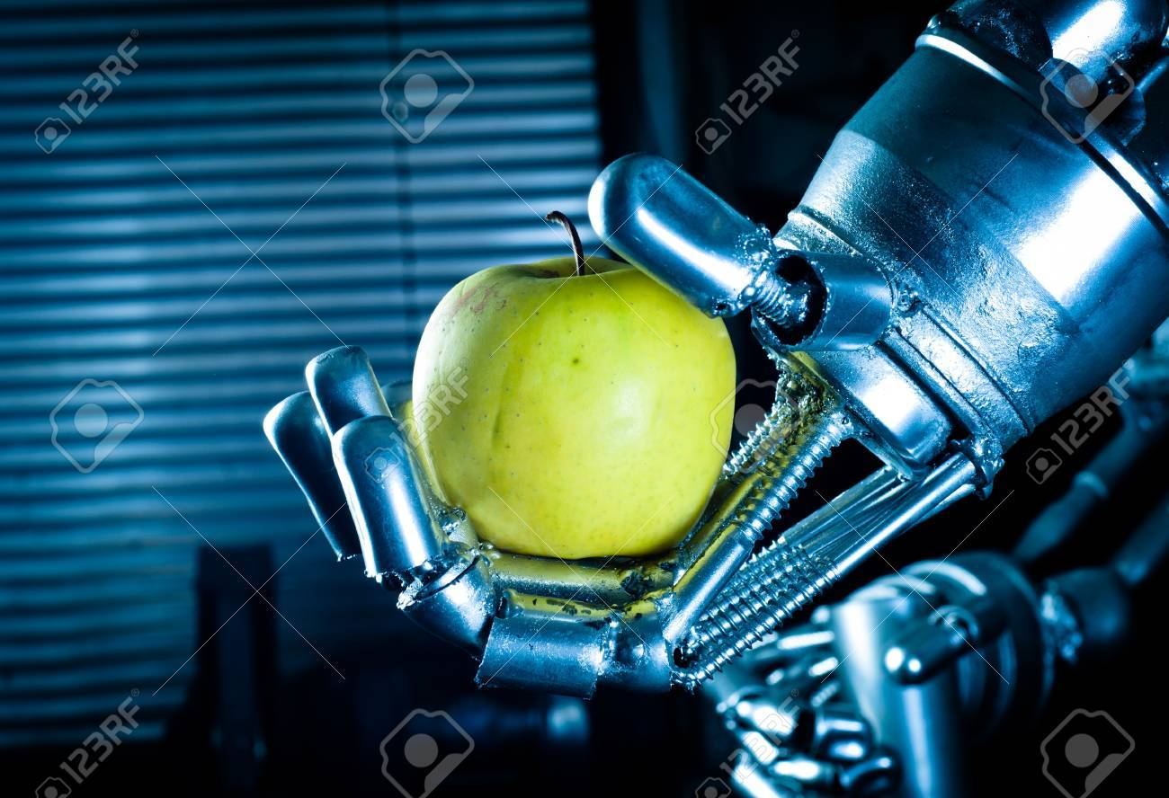 Robot hand holding fresh apple Stock Photo - 12734871