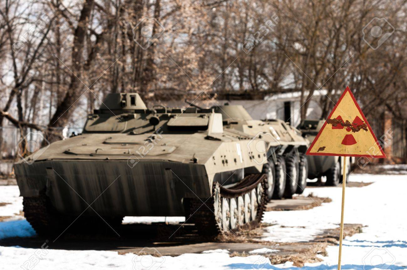 War machines with radioactivity sign at Chernobyl in the winter Stock Photo - 13611096