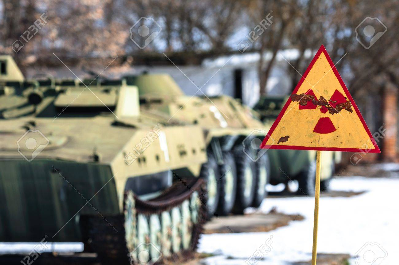 Radiation hazard sign with tanks Stock Photo - 14302233