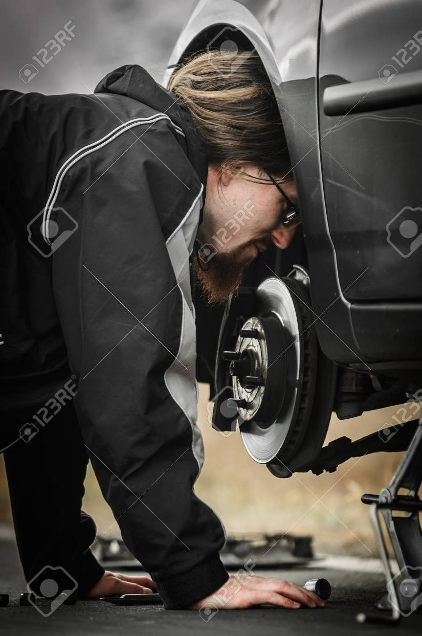 Young man in the middle of a car repair Stock Photo - 15944090