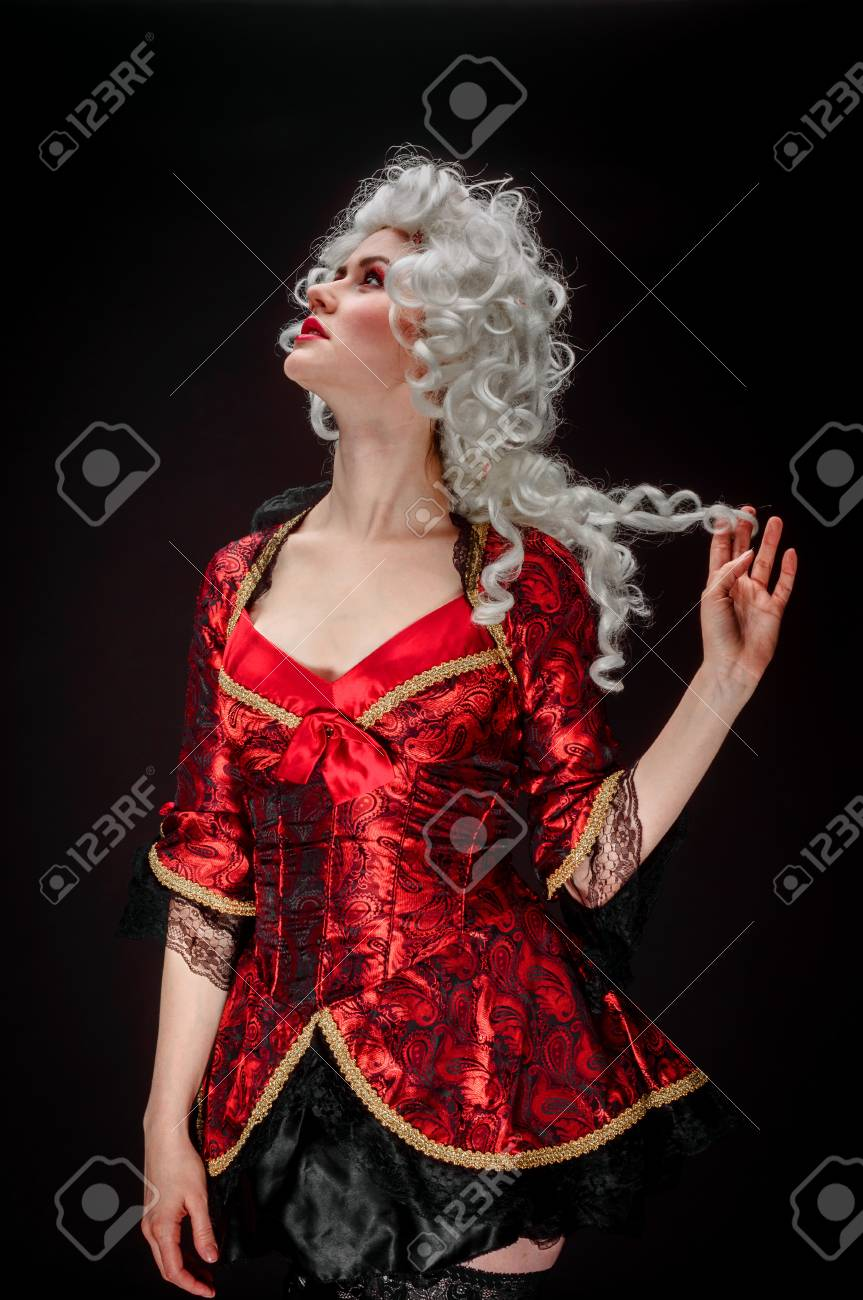 Young woman in baroque costume against dark background Stock Photo - 17017856