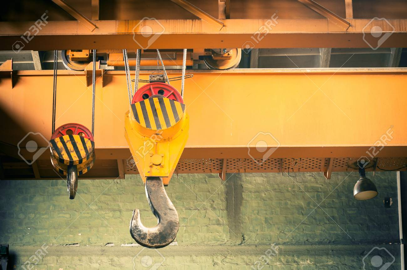 Industrial crane hook in a building Stock Photo - 17022844