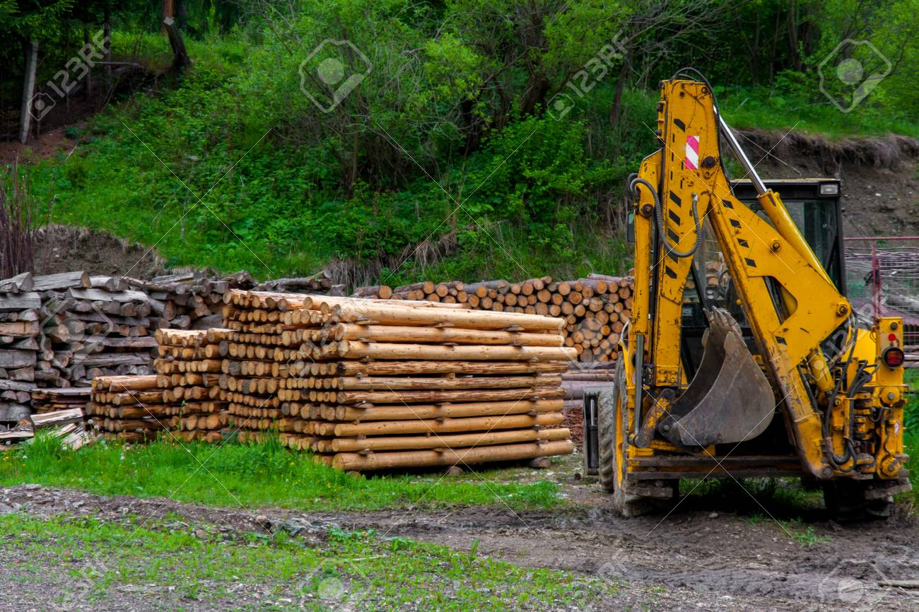 Construction machine and a pile of boards outdoors Stock Photo - 17022457