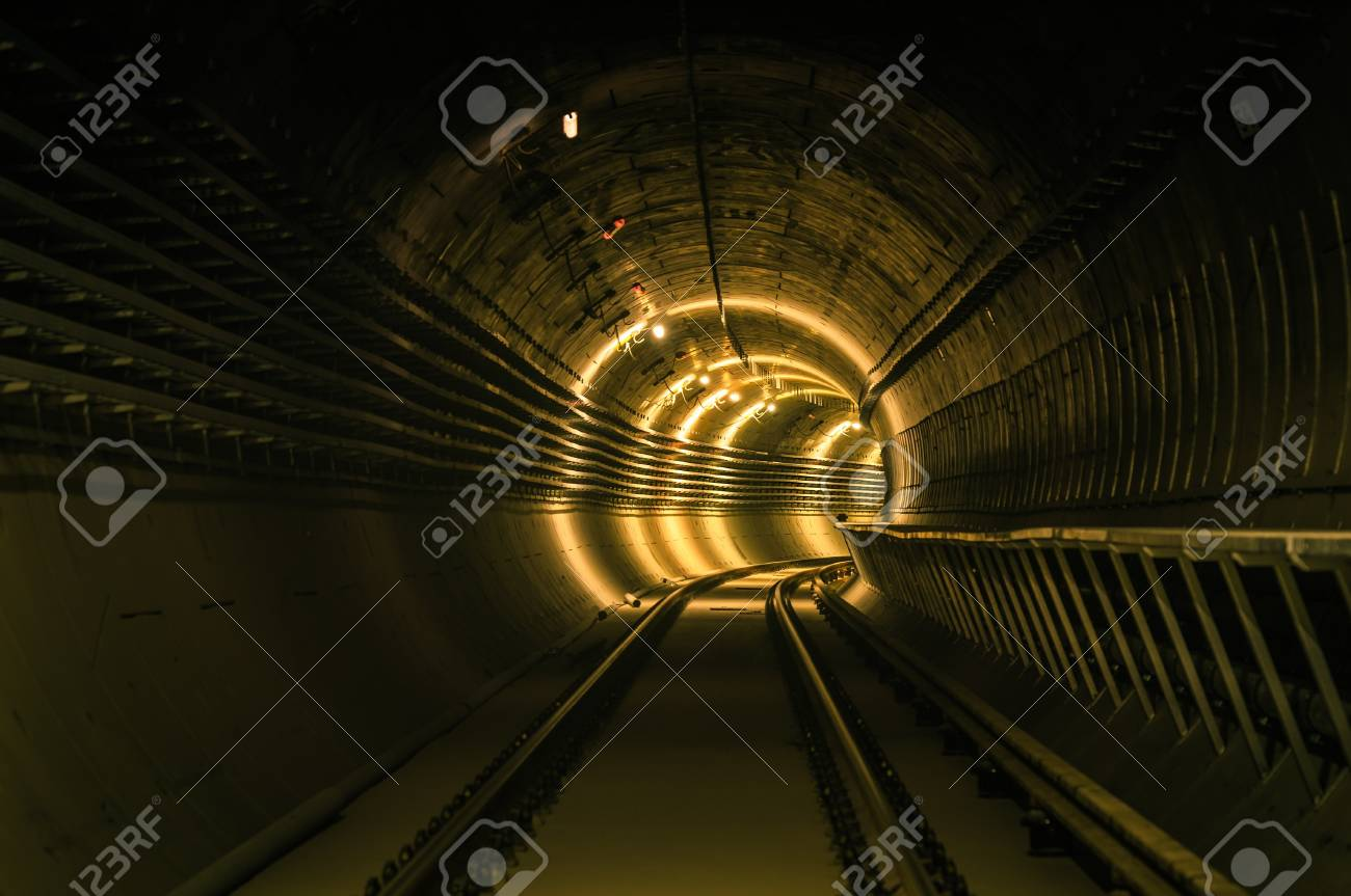 Underground facility with a big tunnel leading deep down Stock Photo - 17682493