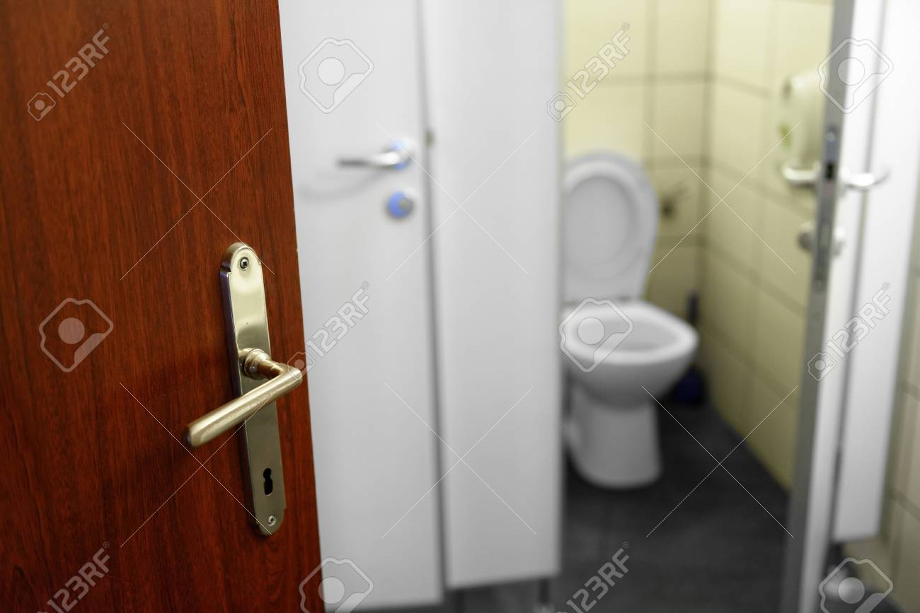 Opened door with toilet in the background Stock Photo - 20086903