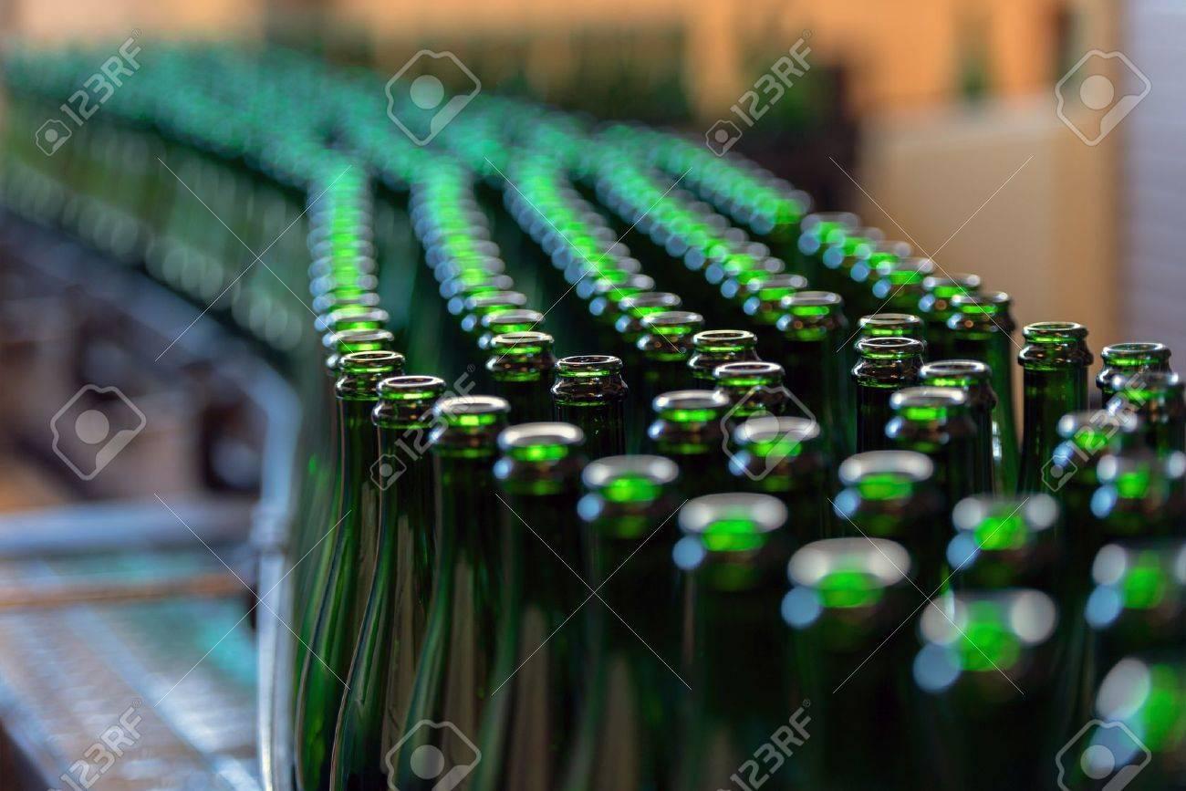 Many bottles on conveyor belt in factory - 40329871