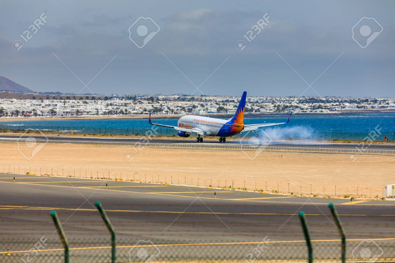 ARECIFE, SPAIN - APRIL, 15 2017: Boeing 737-800 of Jet2holidays with the registration G-JZHA landing at Lanzarote Airport - 81397891