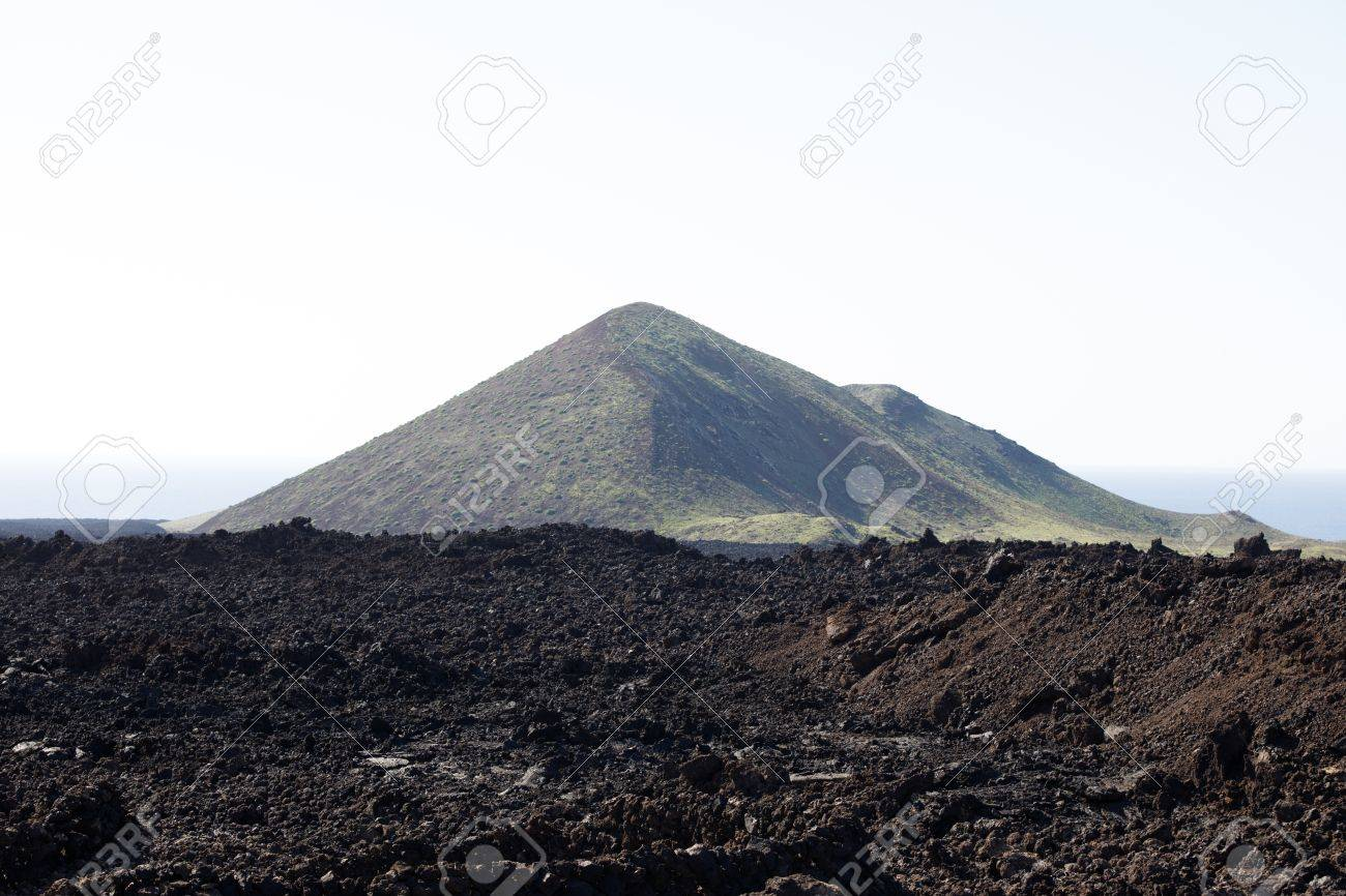 Volcanic, but green landscape on Lanzarote. - 81259916
