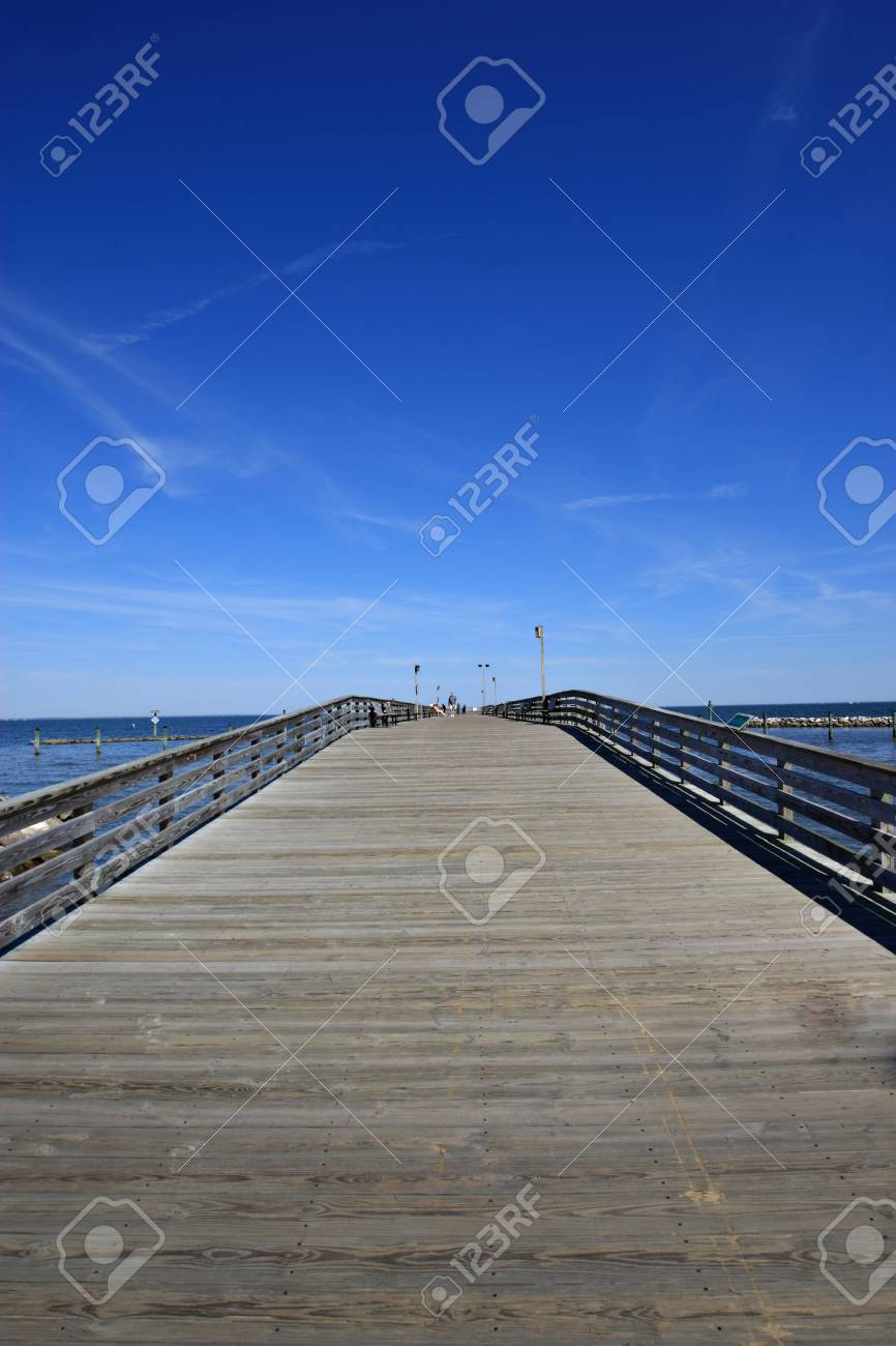 Old wooden pier going into the ocean with a blue sky Stock Photo - 10748949
