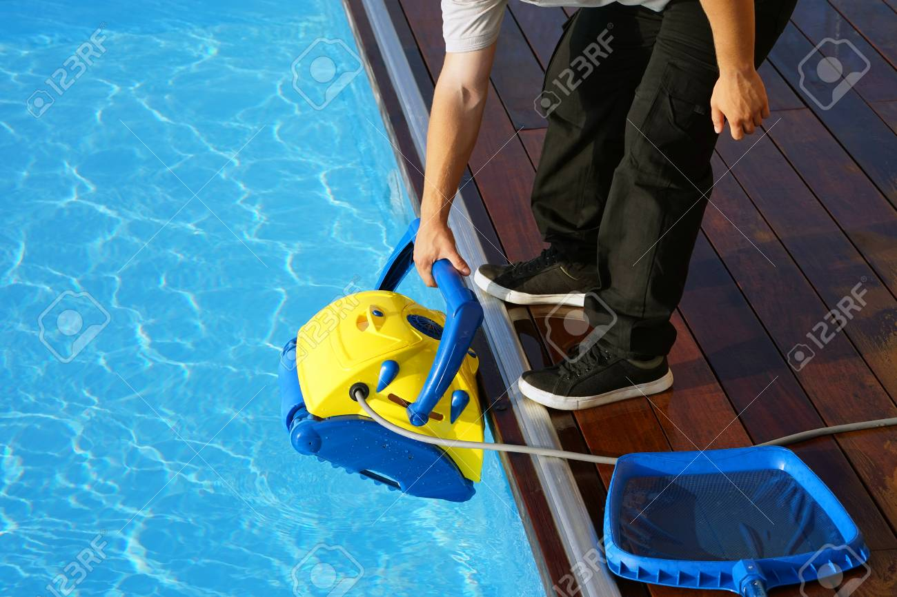 Pool Cleaner During His Work. Cleaning Robot For Cleaning The ...