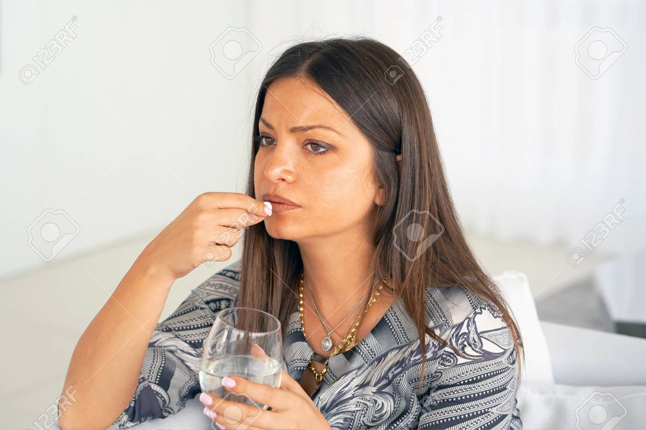 Sick Woman Taking Pill And Holding Glof Water At Home Depressed Unhealthy Woman