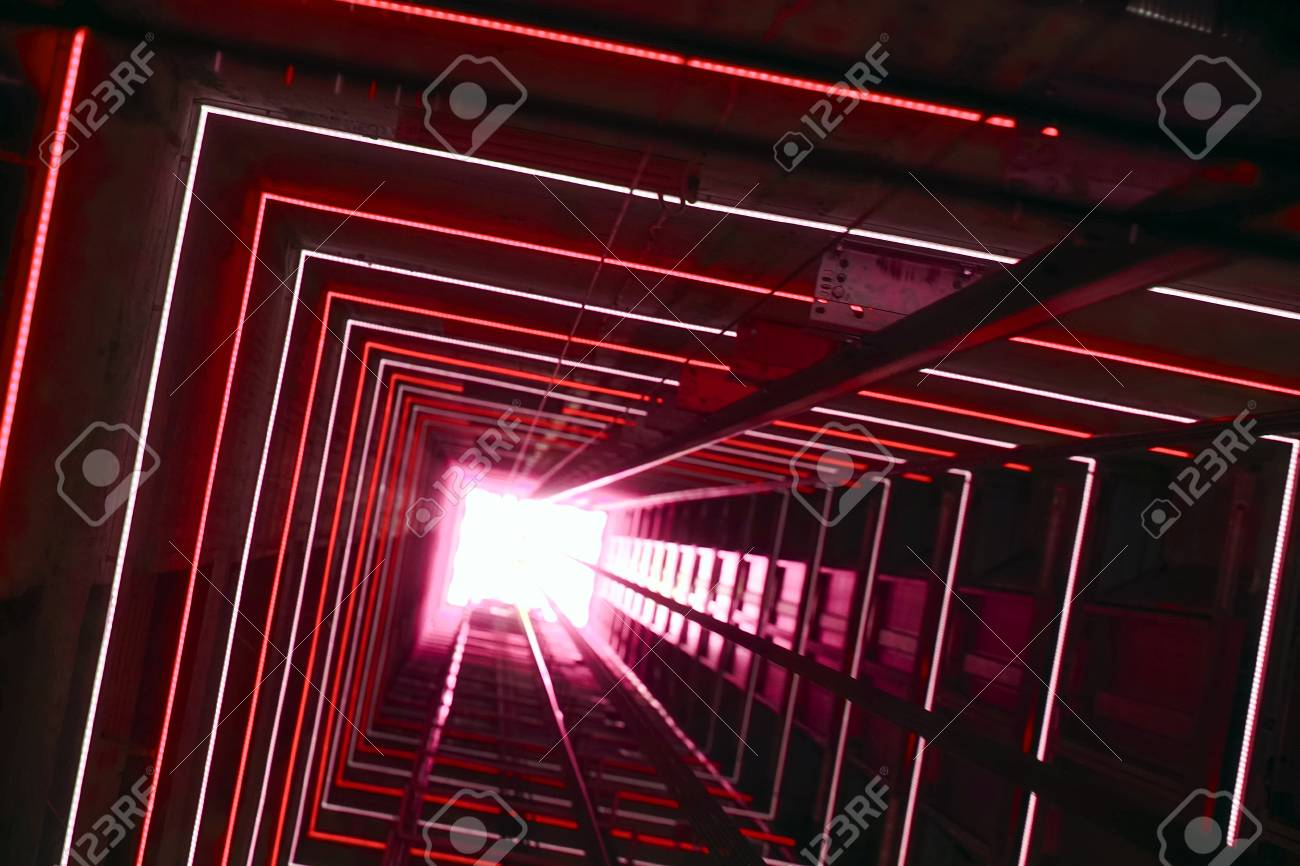 Elevator corridor in the building lit by red elumination  Futuristic