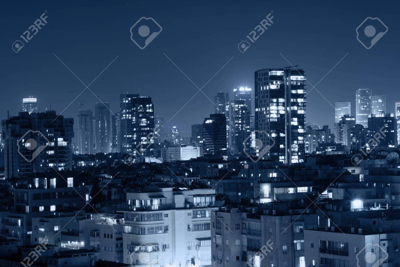 Night view of the city life. Light of the buildings shining with cool blue tones. View of night scene of Tel Aviv, Israel. Blue tone city scape. - 130861878