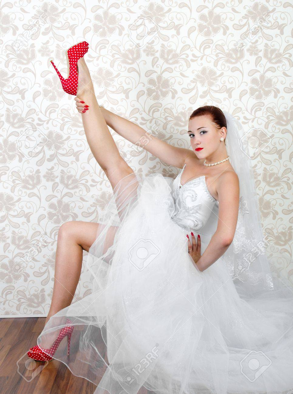 84e9f4cbb5e2c Portrait Of Young Beautiful Bride In Red Shoes Stock Photo, Picture ...