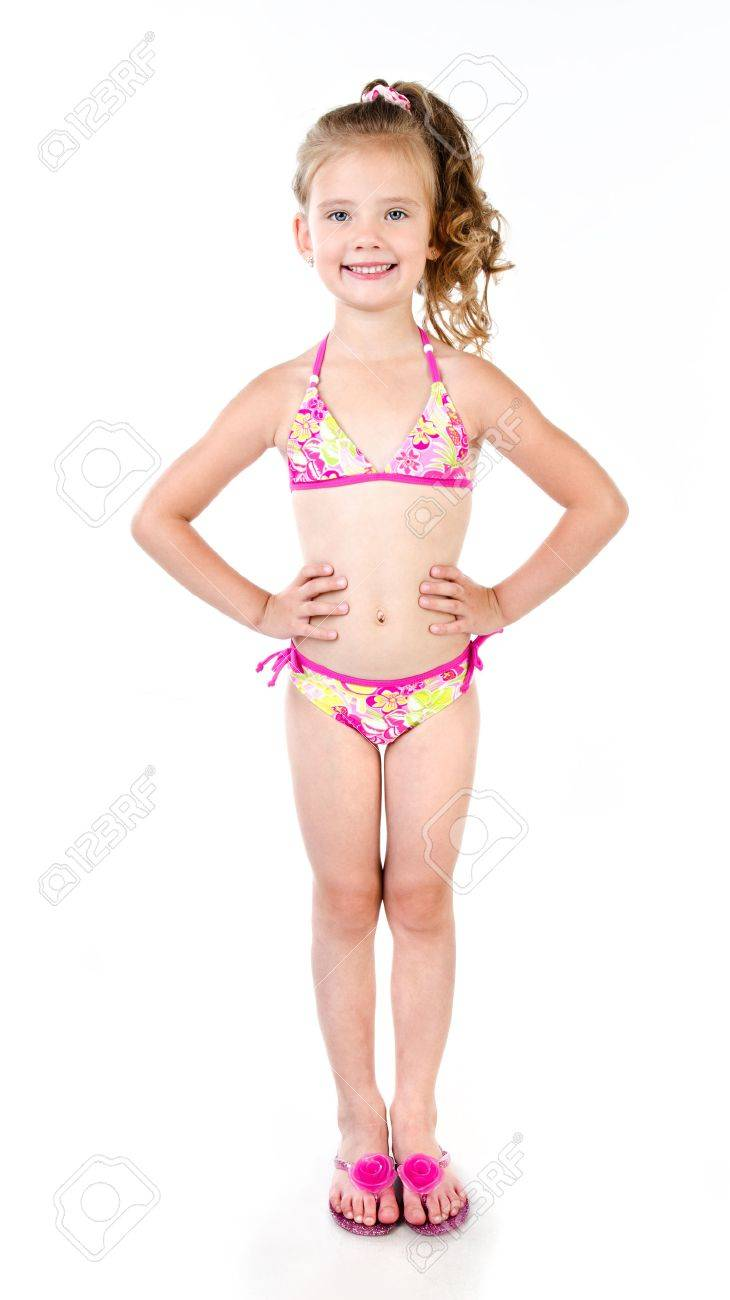 2c734b9114 Cute smiling little girl in swimsuit isolated on a white Stock Photo -  36821244