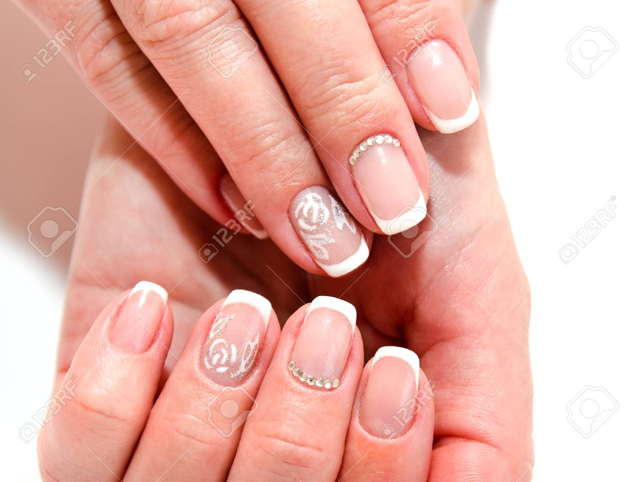 Woman S Nails With Beautiful French Manicure Fashion Design With Stock Photo Picture And Royalty Free Image Image 108743980