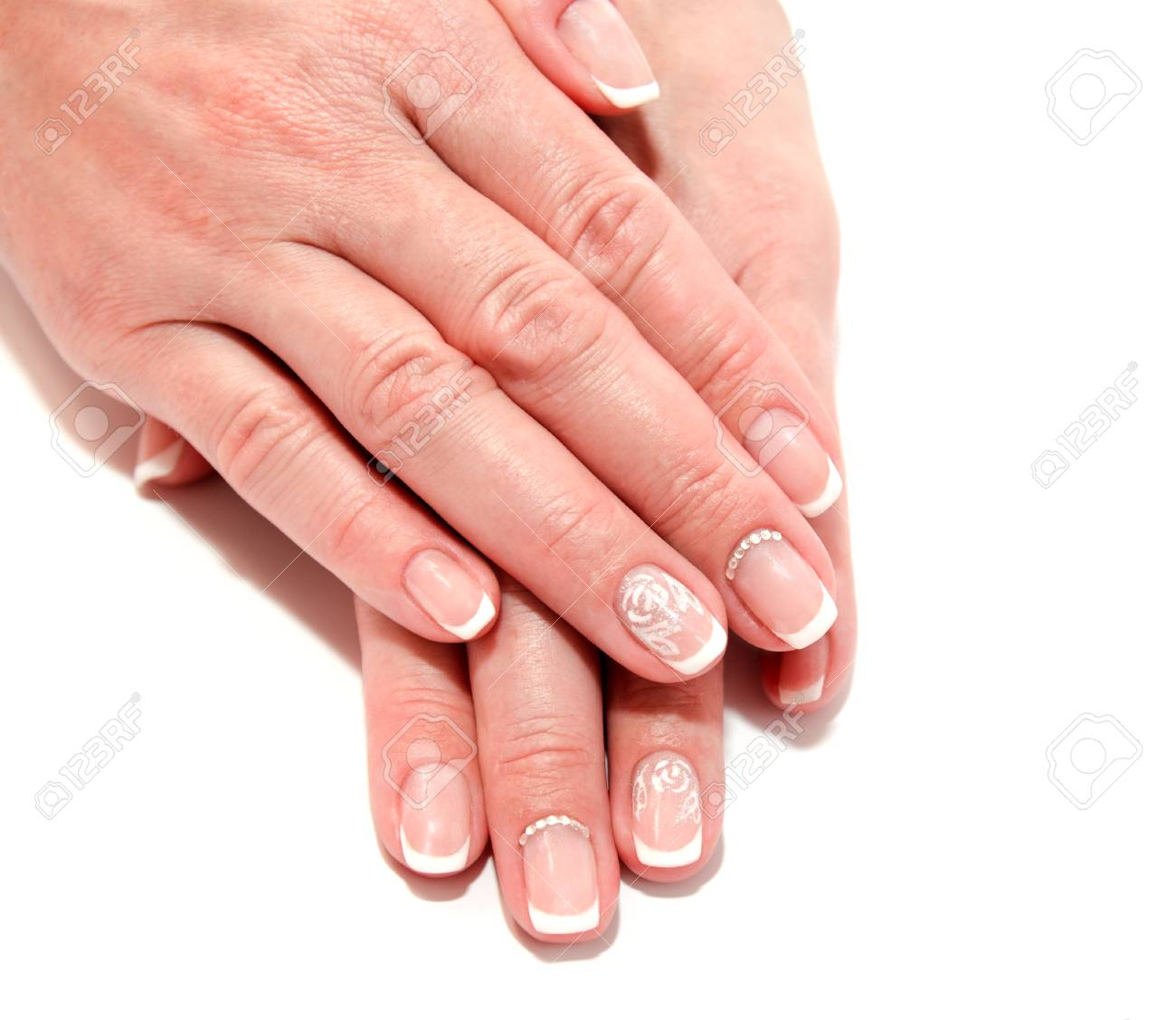 Woman S Nails With Beautiful French Manicure Fashion Design With Stock Photo Picture And Royalty Free Image Image 108743985