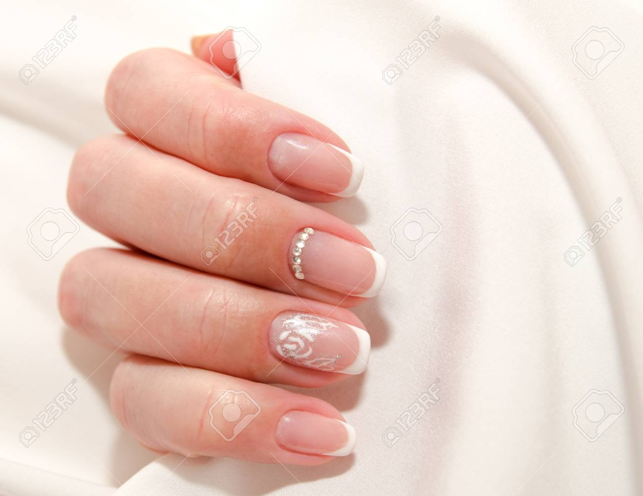 Woman S Nails With Beautiful French Manicure Fashion Design With Stock Photo Picture And Royalty Free Image Image 109703081