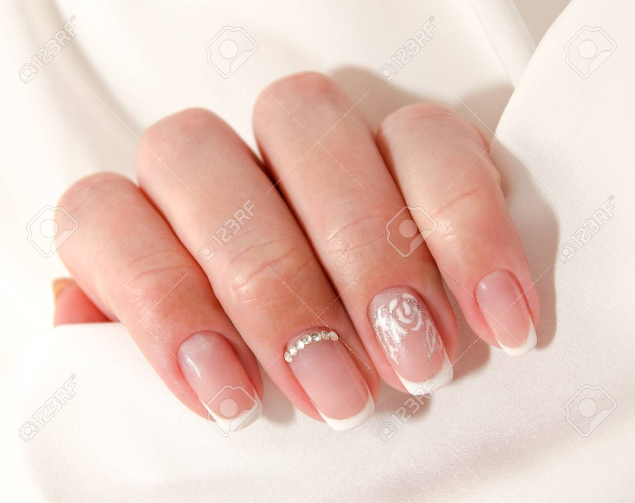 Woman\'s Nails With Beautiful French Manicure Fashion Design With ...