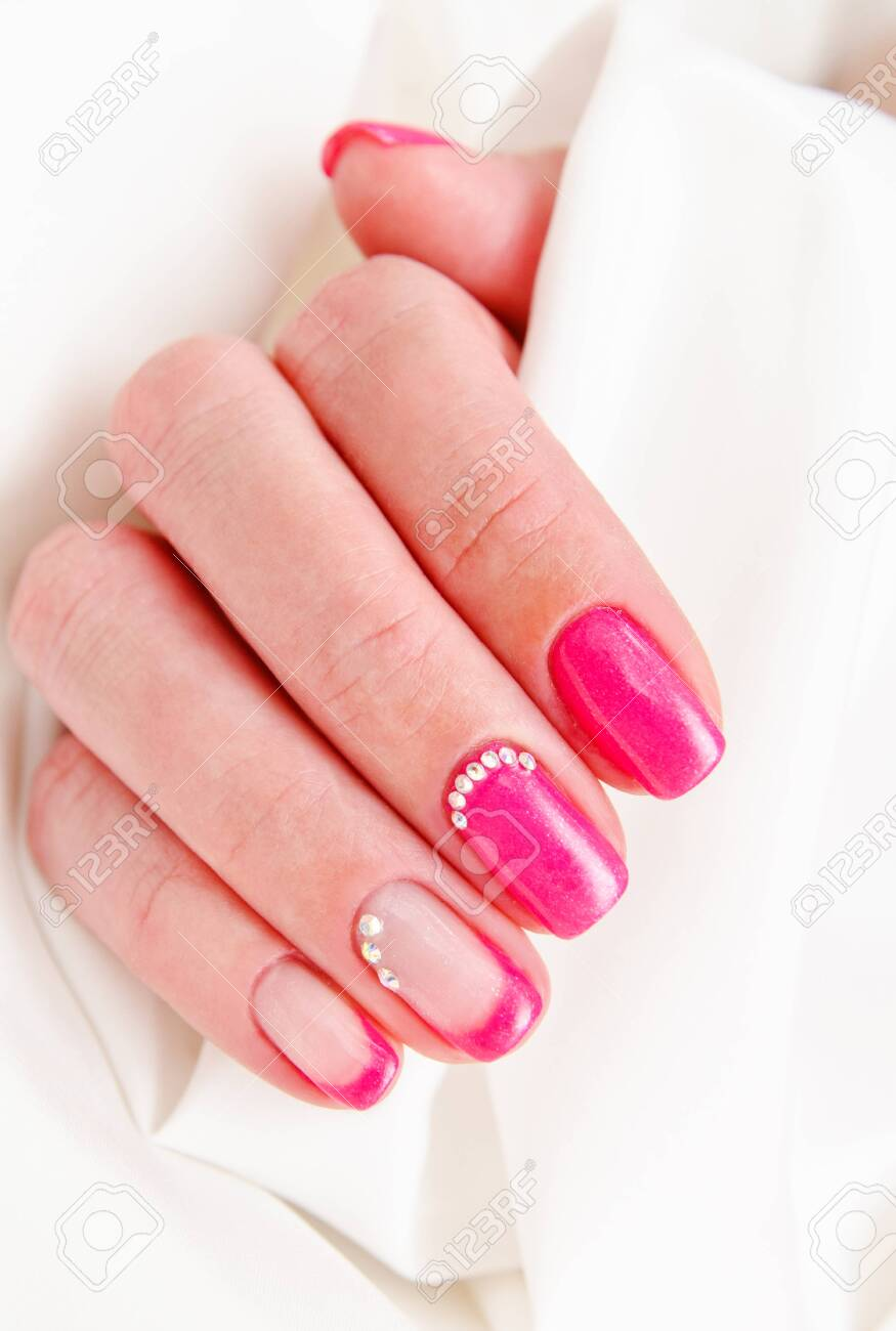 Woman's nails with beautiful manicure fashion design with gems - 121717278