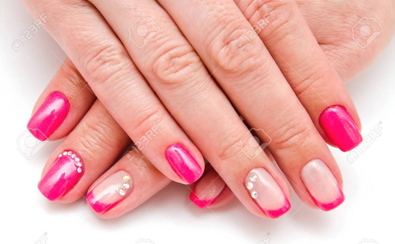 Woman's nails with beautiful manicure fashion design with gems pink color - 123365394
