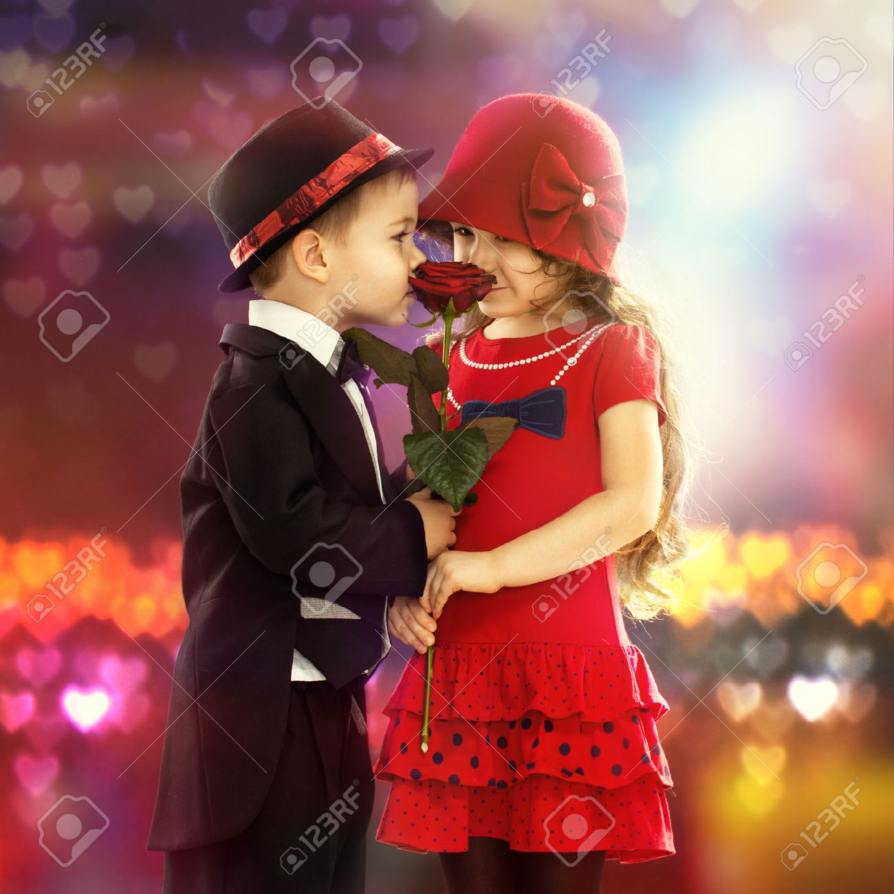 Lovely little boy giving a rose to fashionable girl and her lovely little boy giving a rose to fashionable girl and her excited stock photo 25307774 altavistaventures Images