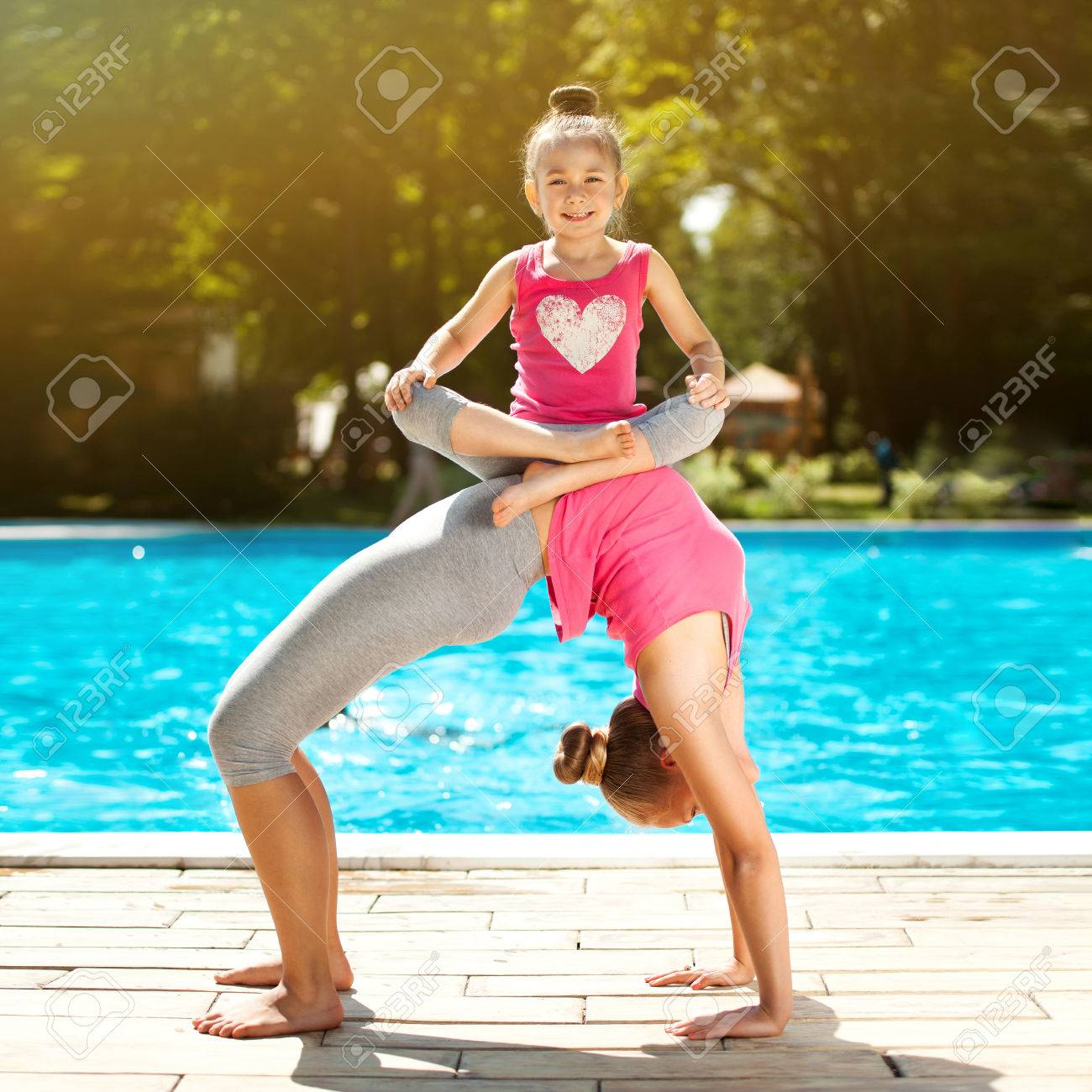 Mother And Daughter Doing Exercise Outdoors Healthy Lifestyle Stock Photo Picture And Royalty Free Image Image 31704000