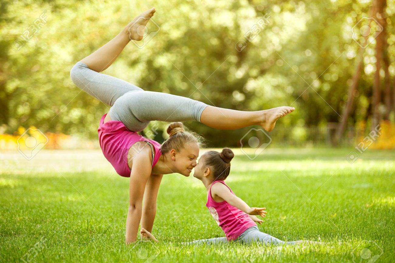 Mother And Daughter Doing Exercise Outdoors Healthy Lifestyle Stock Photo Picture And Royalty Free Image Image 32143962