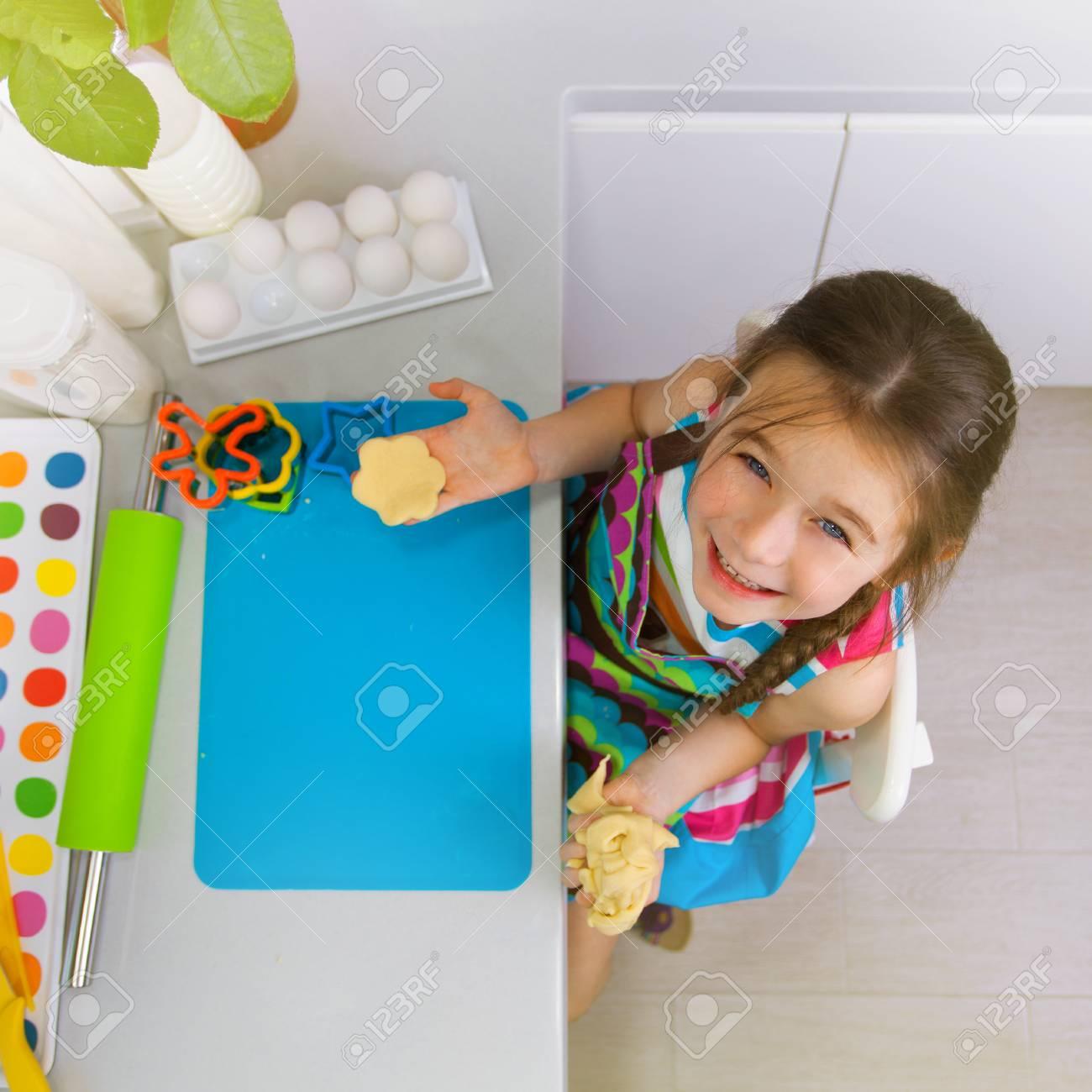 Little Girl Preparing A Cookie On Kitchen. Children Cooking Concept ...