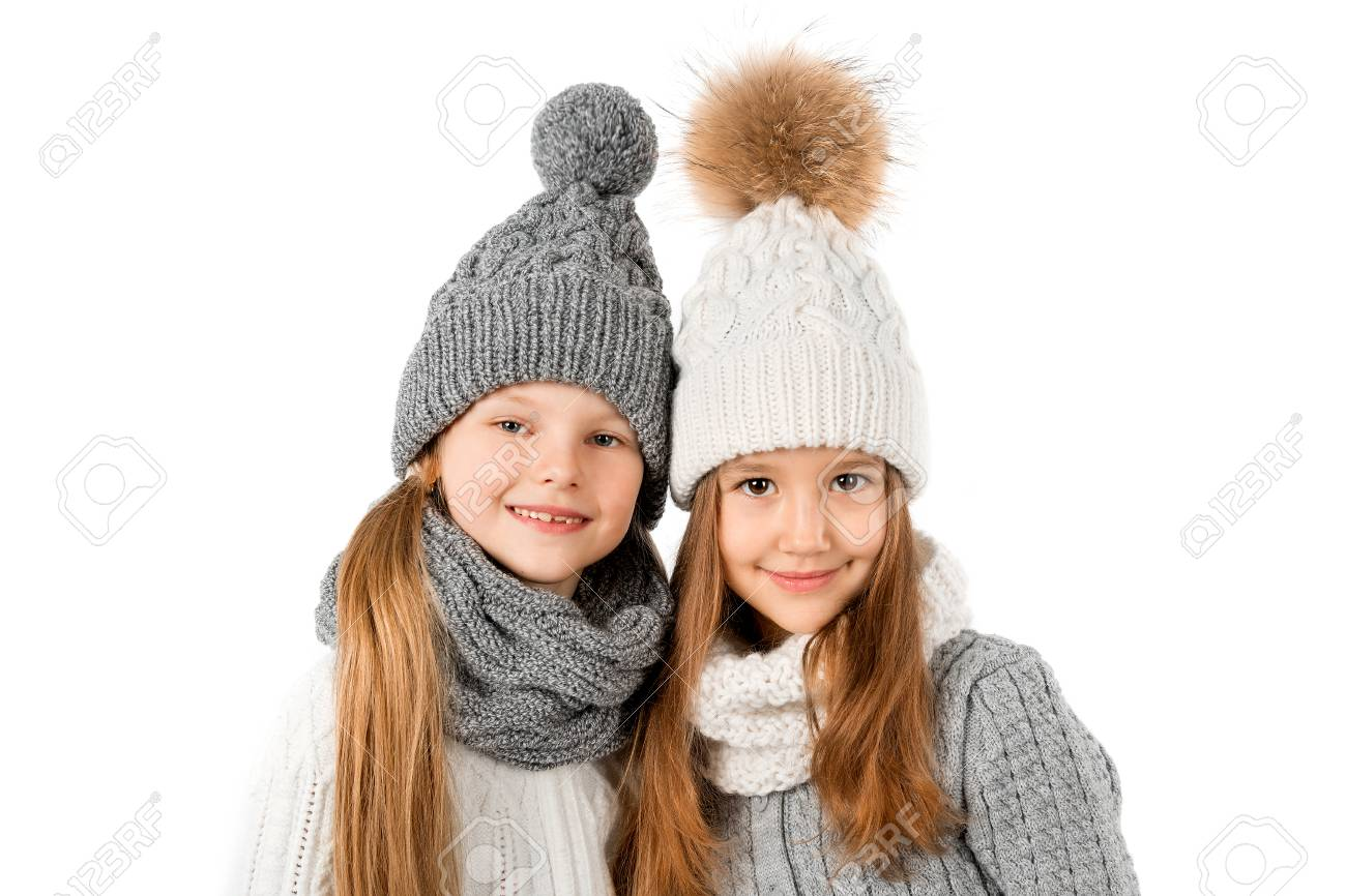 c885f7eb87487 Group of cute kids in winter warm hats and scarfs isolated on white. Children  winter