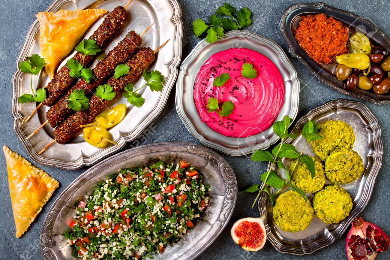 Middle Eastern traditional dinner. Authentic arab cuisine. Meze party food. Top view, flat lay, overhead - 90372476