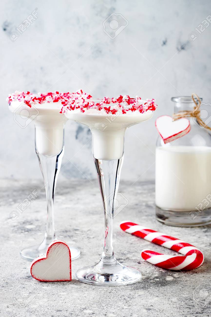 White Chocolate Peppermint Martini With Candy Cane Rim. Christmas ...