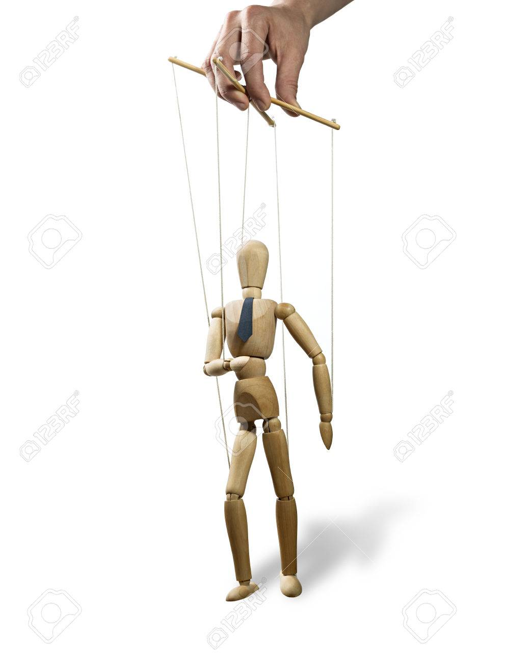 Puppet in the hands of puppeteer walks on isolated, white background