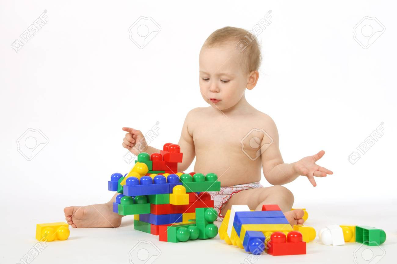The small child plays the designer a white background Stock Photo - 4738969