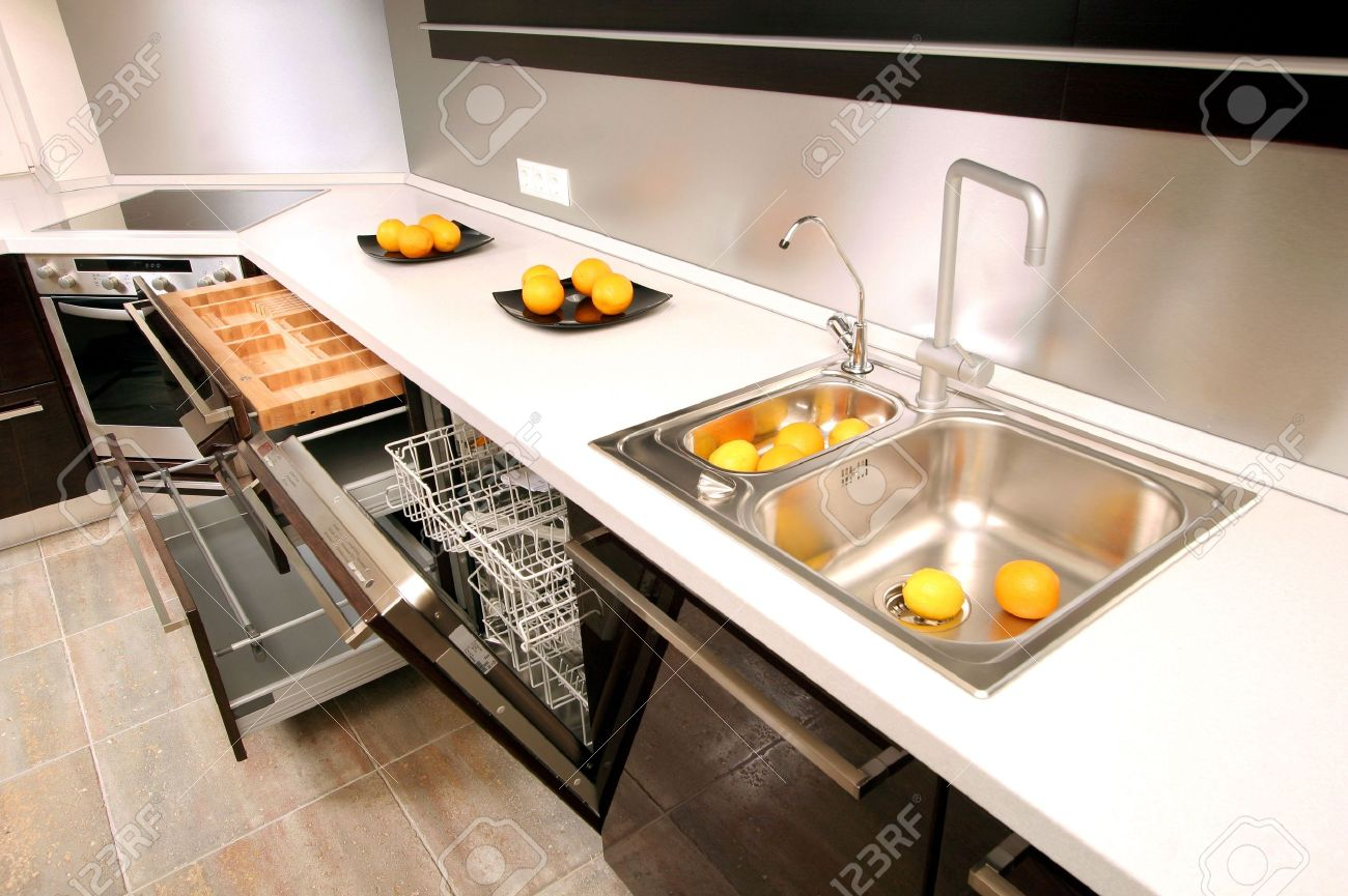 Modern Kitchen With The Built In Home Appliances Stock Photo