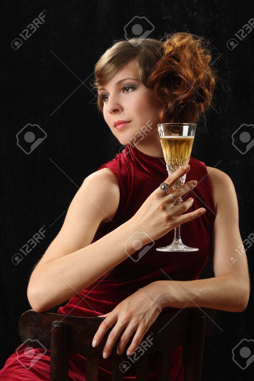 The beautiful girl with a wine glass Stock Photo - 5151892