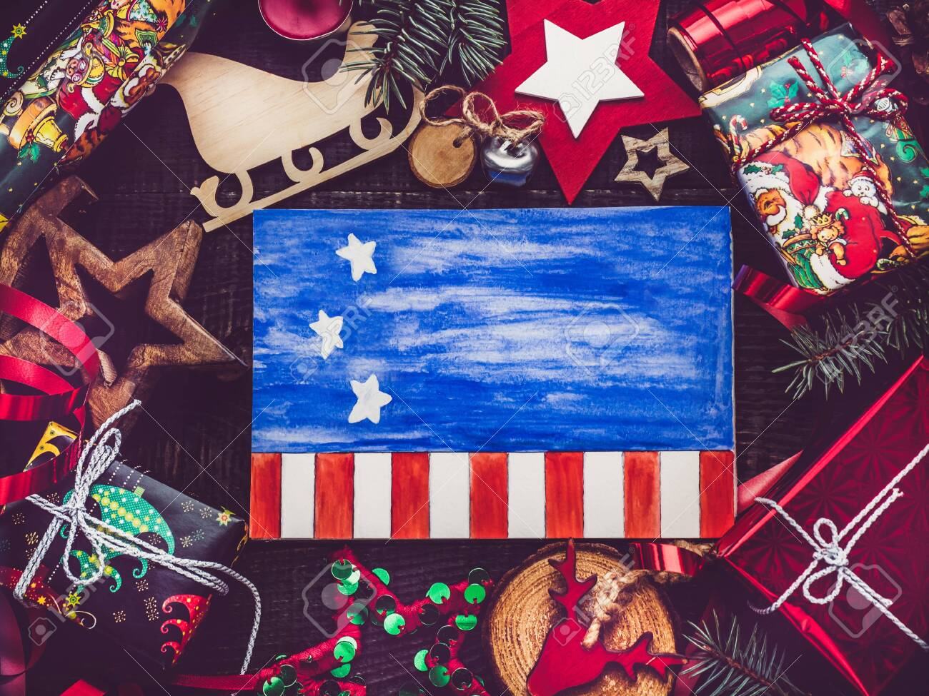 Merry Christmas and Happy New Year. Beautiful card with American flag pattern. View from above, close-up, flat lay. Congratulations to loved ones, family, relatives, friends and colleagues - 129804055