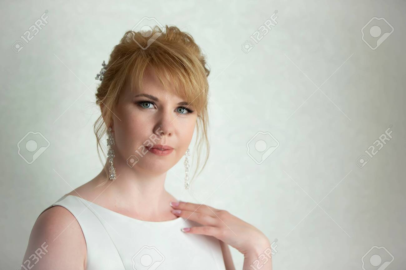 Portrait of a fair-haired woman. European-style girl. - 154206075
