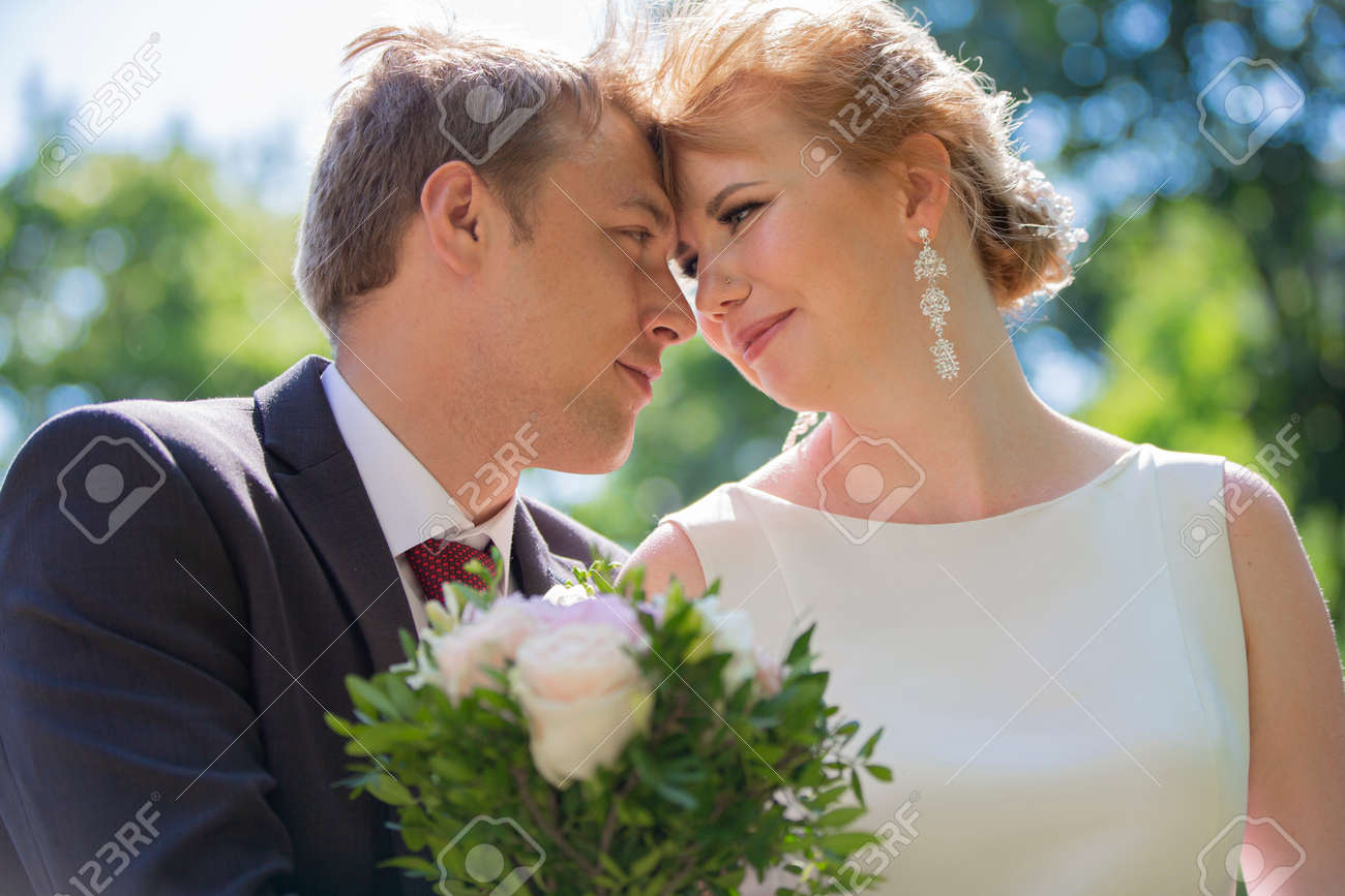 Beautiful bride and groom. Lovers. Newlyweds with a bouquet. - 154206096