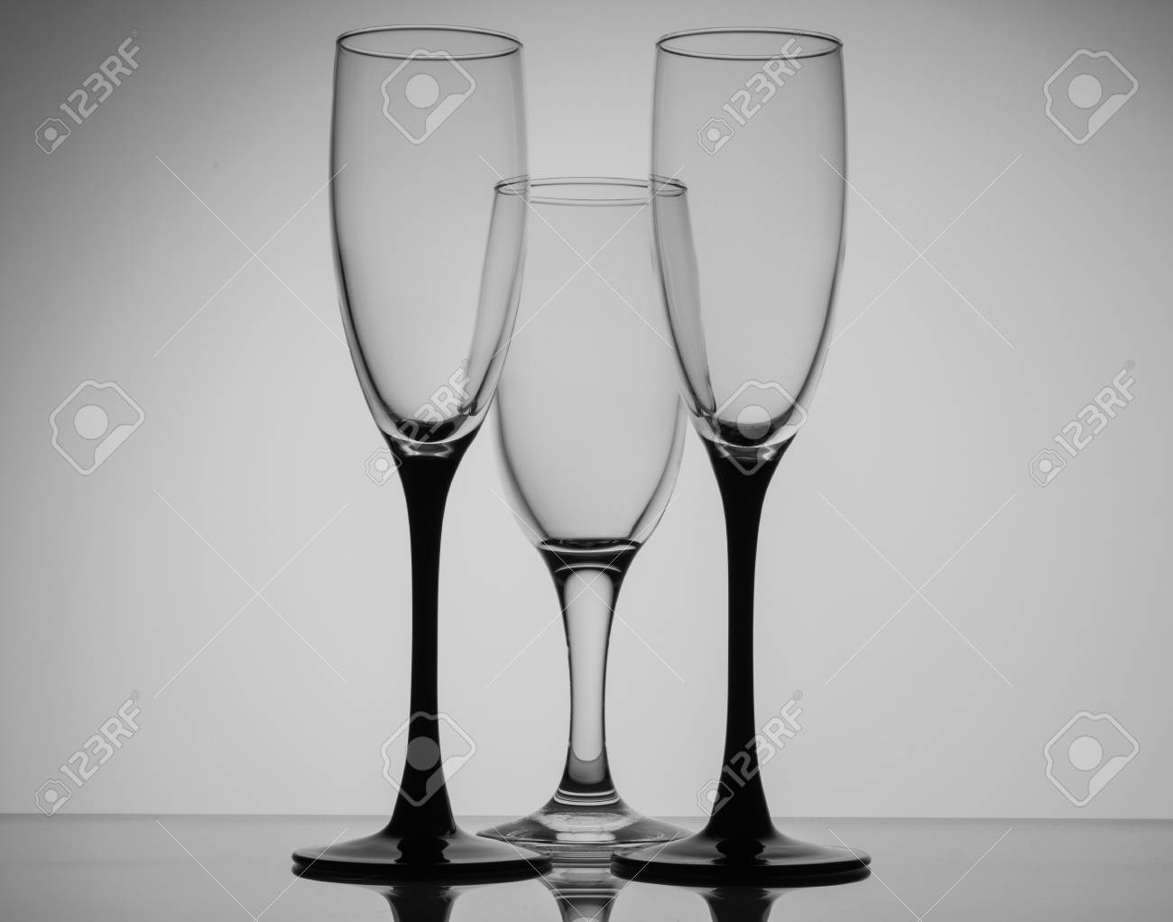 297480293e9 Silhouette champagne glasses black and white on grey background Stock Photo  - 64720494
