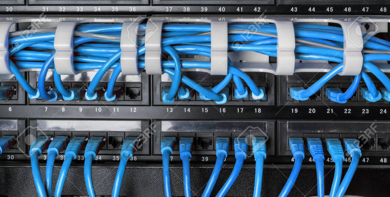 Server Rack With Blue Internet Patch Cord Cables Connected To ...