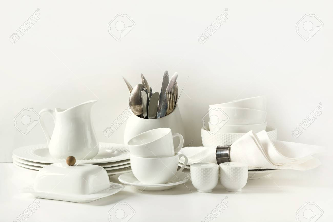 Stock Photo - White tableware for serving. Crockerydish utensils and other different white stuff on white table-top. Kitchen still life. Copy space. & White Tableware For Serving. Crockerydish Utensils And Other ...