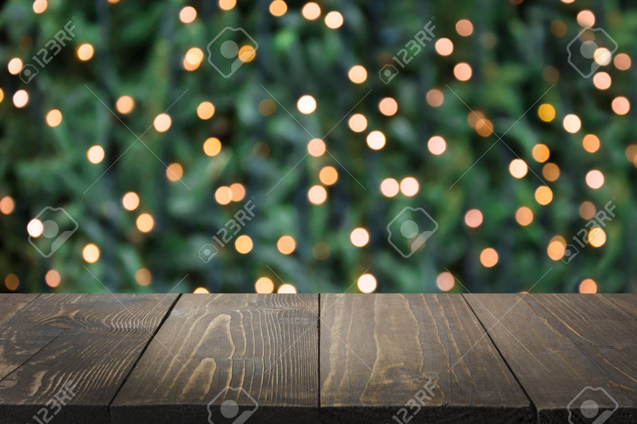 Blurred Gold Garland On Christmas Tree As Background And Wooden