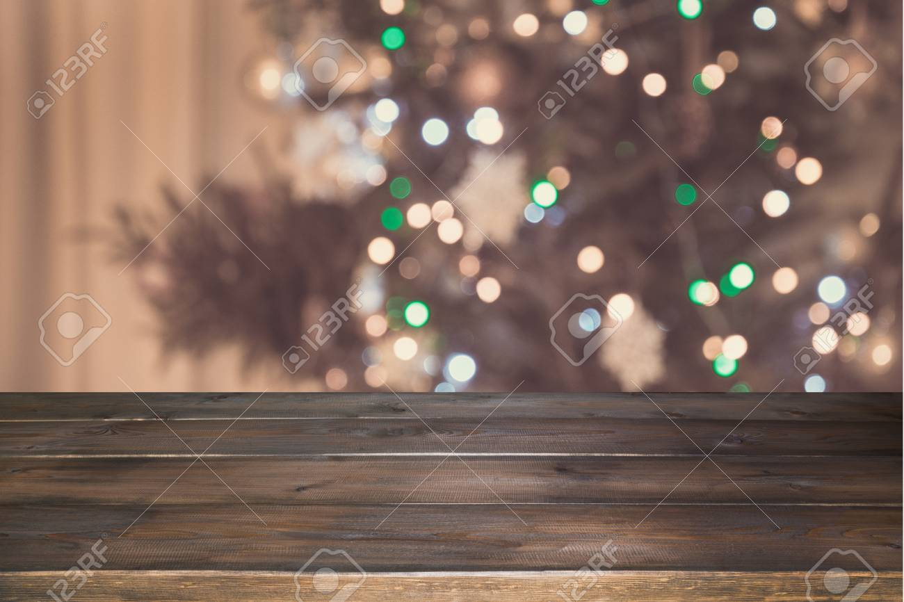 Wooden Tabletop And Blurred Christmas Tree In Interior Xmas