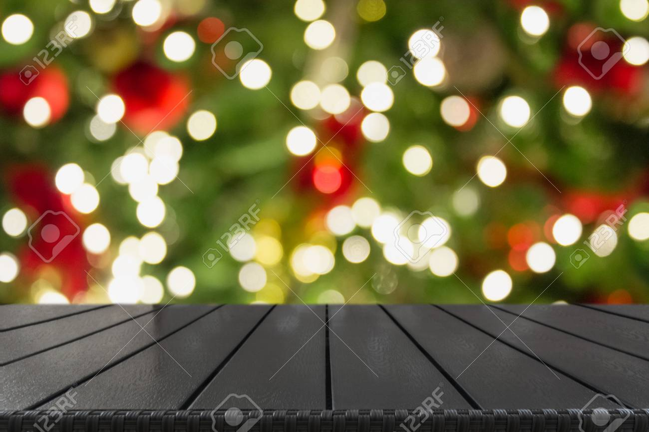 Wooden Dark Tabletop And Blurred Christmas Tree Bokeh Xmas Background