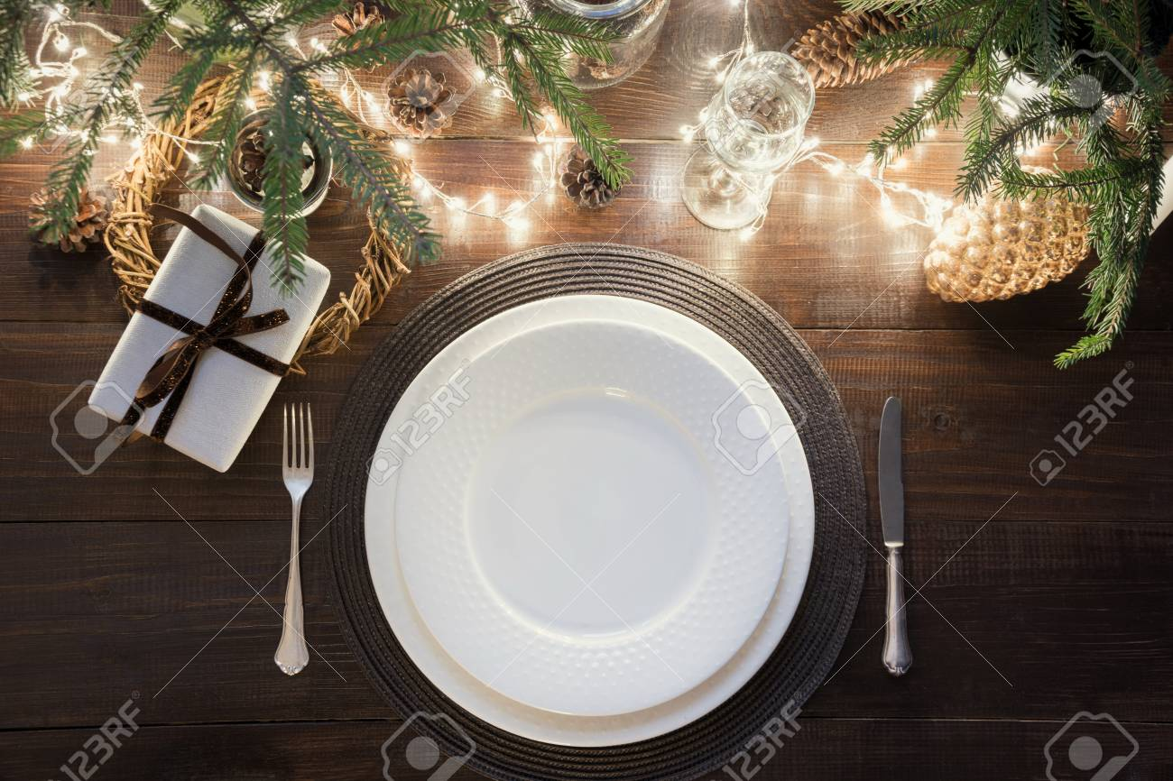 Christmas Table Setting With Silverware Garland And Dark Natural