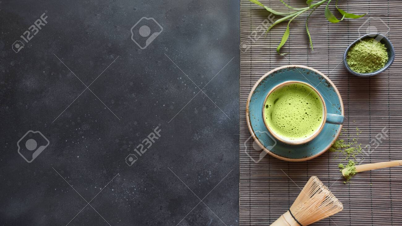 Still life with Japanese matcha green tea with accessories on black table. View from above. Space for text. - 125043266