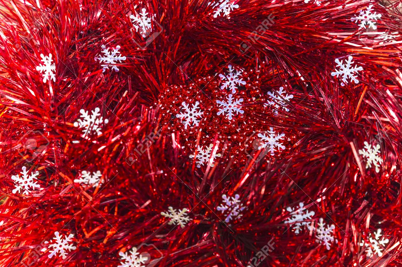 christmas and new year abstract festive background of red tinsel and snowflakes stock photo